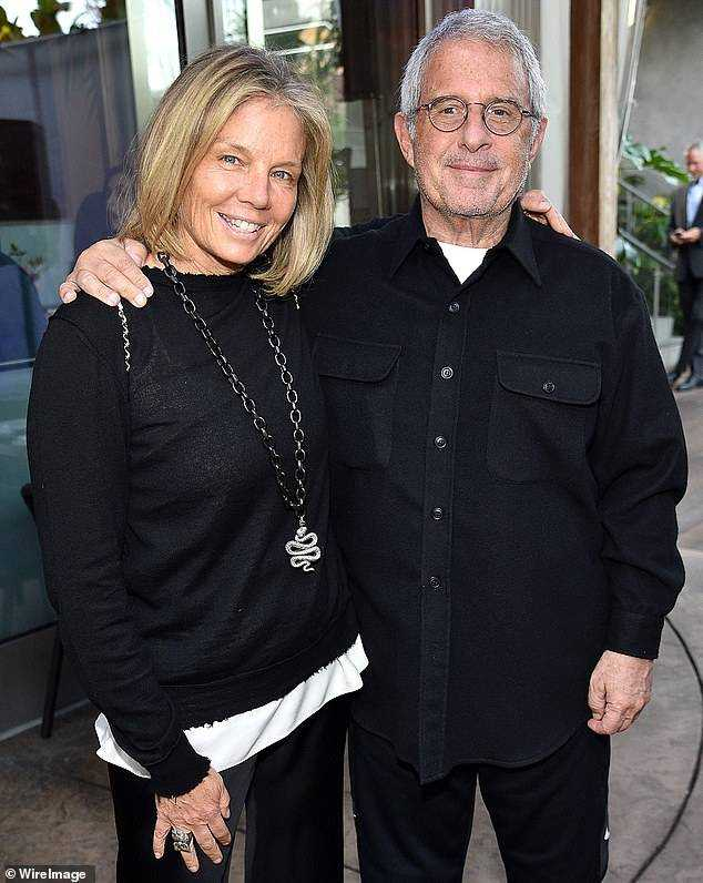 A source close to Meyer said the Hollywood legend, who co-founded the main agency CAA, kept his giant gambling debts hidden from his family - until the truth was revealed during his split from his second wife Kelly. Chapman (pictured together in 2017)